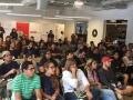 Participantes del Include-a-thon escuchando una conferencia