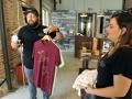 Emilio Meléndez y Vanessa Cardez muestran camisas que tienen en venta